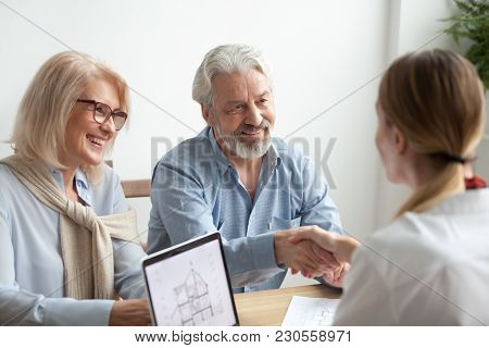 Smiling Satisfied Senior Couple Making Sale Purchase Deal Concluding Contract Handshaking Real Estat