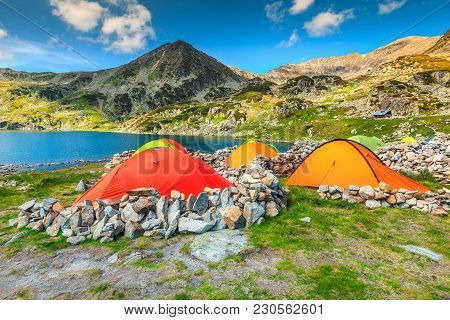Wonderful Alpine Camping Place With Colorful Tents Near Bucura Glacier Lake. Stunning Mountain Campg