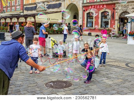 Wroclaw/poland- August 19, 2017: Young Man - Street Entertainer - Playing With Children, Making Soap