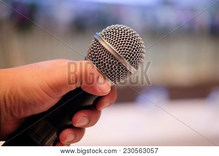 Close Up Of A Man Holding Microphone - Public Speaking, Conference, Reportage
