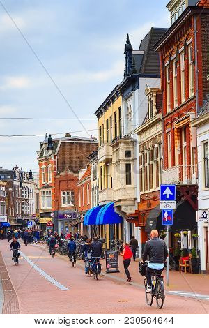 Haarlem, Netherlands - April 2, 2016: Street View With Beautiful Traditional Houses, People In Haarl