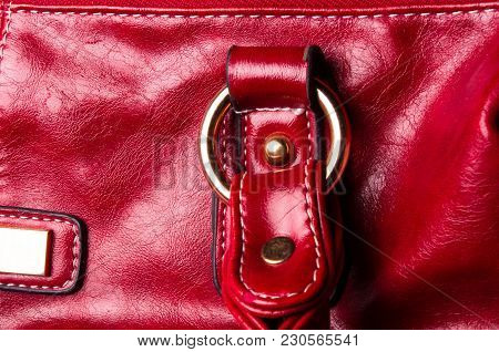Closeup Of Buckles, Clasps, Zippers, Pockets, Fasteners, Fittings And Seams On The Red Hand Bag