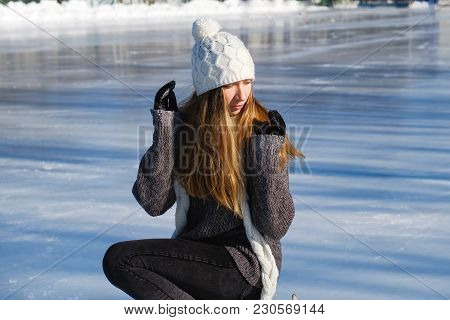 Young Beautiful Girl Ice Skating Outdoors On The Rink