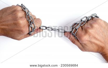 A Steel Chain In The Hands. Isolated On White Background.