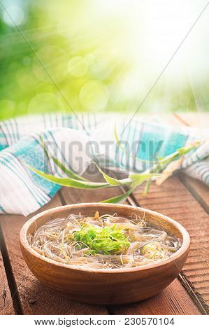 Japanese Cuisine, Soup With Chashu Pork, Chives, Sprouts, Noodles And Seaweed On The Table Under The