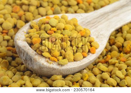 Flower Bee Pollen And A Wooden Spoon. Natural Remedy For Immunity Enhancement. Beekeeping Products.