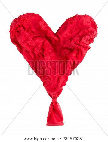 A Dried Red Heart On A White Background.  The Concept Of Love That Ended Or Died.