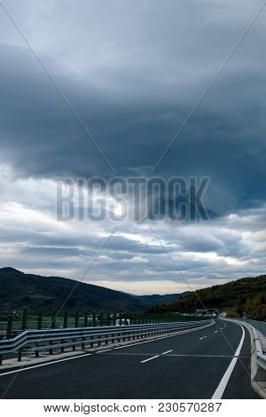Highway And Stormy Dramatic Sky