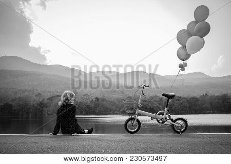 A Women Sitting Alone On The Road Waiting For Love, Alone Concept