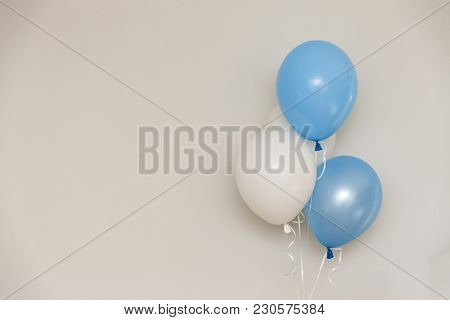 Blue And White Balloons On Light Grey Wall Background. Gender Reveal Party.