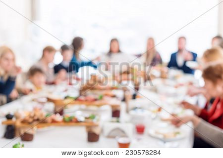 Abstract Blurred Group Of Friends Meeting In The Restaurant. Blurry Background Of Caucasian People H