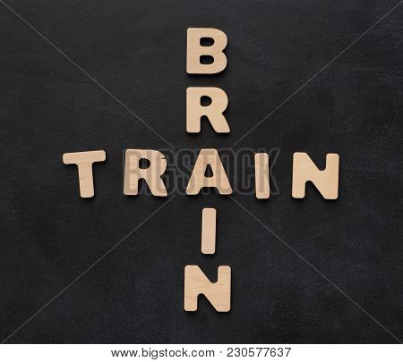 Brain Train Phrase Spelled With Wooden Letters On Black Background. Inspiration, Creativity, Imagina