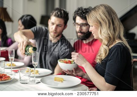 Eating dinner with friends