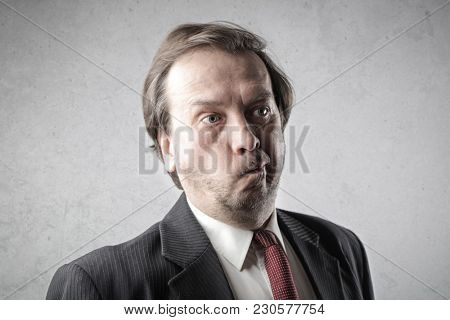 Portrait of disappointed businessman