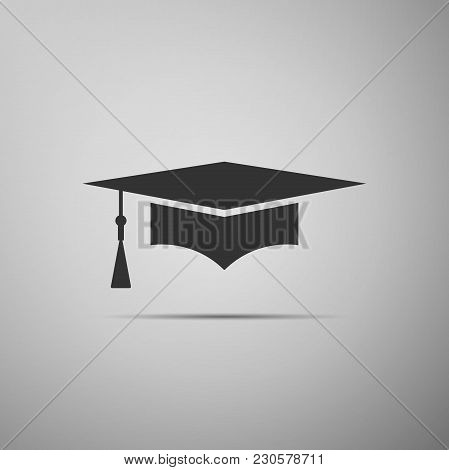 Graduation Cap Icon Isolated On Grey Background. Graduation Hat With Tassel Icon. Flat Design. Vecto