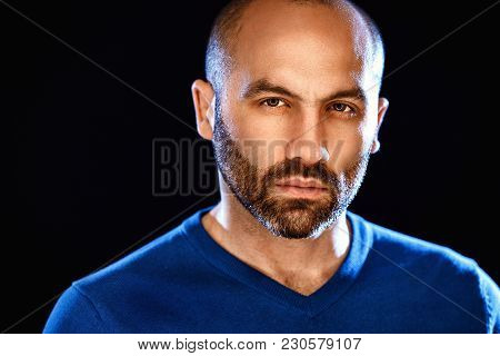 Portrait Of Masculinity. Portrait Of Handsome Young Bald Bearded Man Looking At Camera While Standin