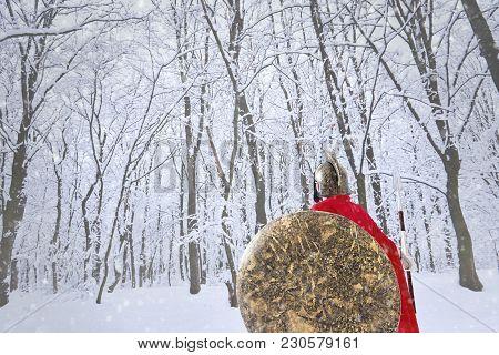 Spartan Warrior Is Stealing In Winter Forest.
