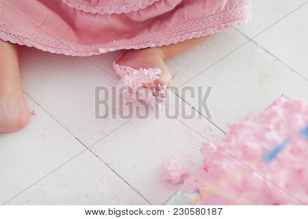 Baby Girl Legs Feet Stepping In Cake During Her Birthday Celebration - Close-up Shot. Cake-smash Fir