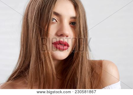 Headshot Of Flirty Caucasian Attractive Model With Eye Make Up And Red Lipstick Looking To Camera Wh