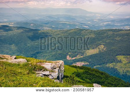 Rocky Cliff Over The Valley With Rolling Hills. Lovely Mountainous Scenery With Deep Perspective