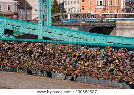Wroclaw, Poland - March 9, 2018: View Of Symbolic Love Padlocks Fixed To The Railings Of Grunwaldzki