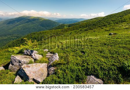 Beautiful Mountain Landscape On Summer Morning. Boulders Among The Grass On Hillside