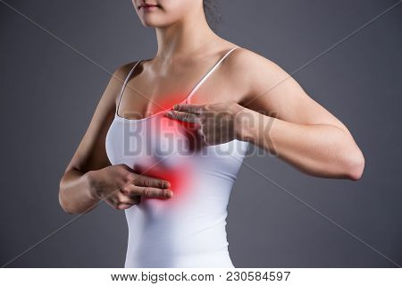 Breast Test, Woman Examining Her Breasts For Cancer, Heart Attack, Pain In Human Body On Gray Backgr