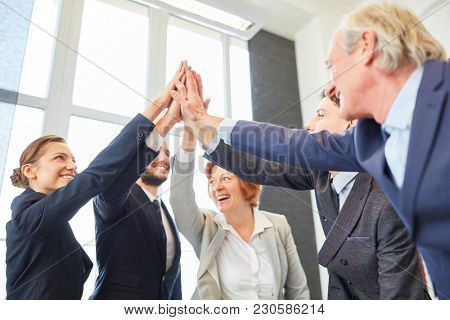 Business team share High Five for team building or team spirit