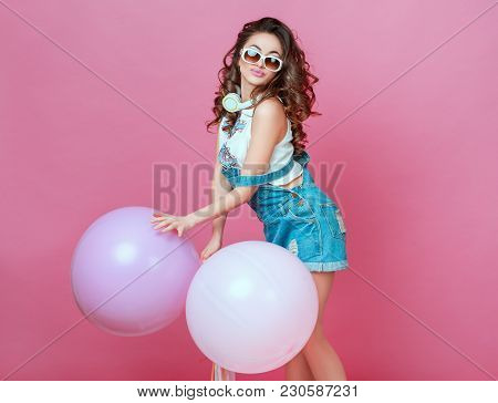 Cheerful Beautiful Young Girl In Glasses With Helium Balloons Enjoying Birthday Photoshoot Dancing A