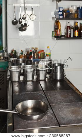 Modern Shiny Kitchen With Stainless Steell Kitchenware And Equipment For Restaurant Cooking