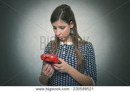 Woman Watching On Red Alarm Clock In Her Hands And Sets The Time On The Clock. Time Management.