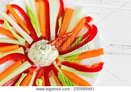 Colorful Vegetable Sticks With Dip Sauce In A Plate On White Wooden Table. Healthy Appetizer Crudite