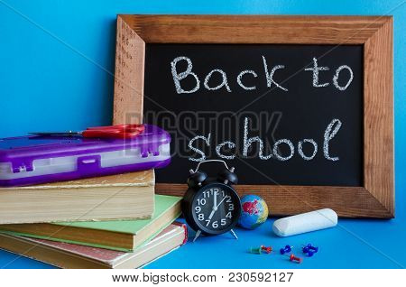 Back To School Concept With Stationery. School Supplies On Blue Background. Frase Back To School Wri