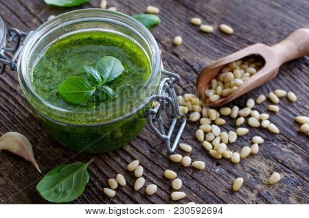 Pesto Genovese - Traditional Italian Green Basil Sauce With Pine Nuts, Basil And Garlic On Rustic Wo