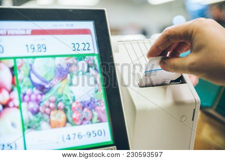 Man Weigh Fruits On Digital Scales. Shopping Concept