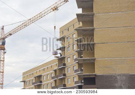 Krasnodar, Russia- February 13, 2016: The Construction Of High-rise Buildings. Construction Cranes A