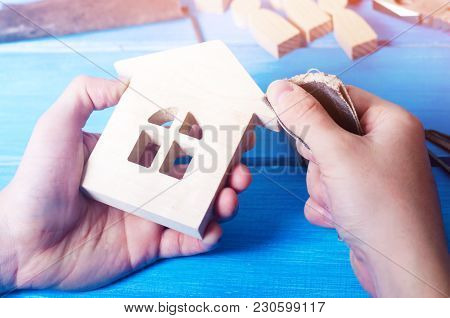 Men's Hands Make A Hand-made Article Of Wood On The Background Of A Blue Table With Tools. Work At H