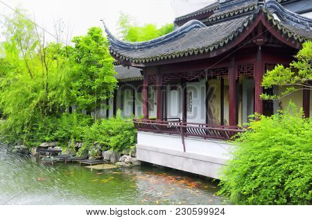 A Pond In Front Of A Building In The Classical Chinese Li Yuan Garden In Zhaojialou Shanghai China.