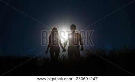 Sillhouette. Couple Holding Hands In Love, Backlight