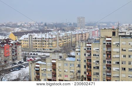 Residential Buildings At The End Of A Winter During A Day