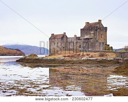 Eilean Donan Castle With A Stone Bridge Above The Water,  Scotland,  It Was Destroyed During The Jac