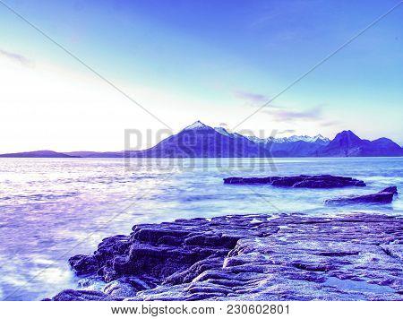 Rocks Near Elgol,  Loch Scavaig,  Isle Of Skye Scotland. Warm Sunset Colors In Cold February Evening