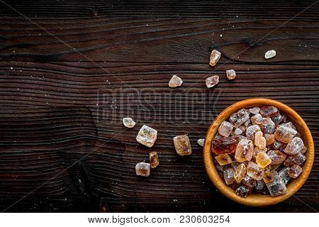 Types Of Sugar. Candy Brown Sugar In Bowl On Dark Wooden Background Top View.