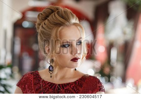 Elegant Blonde Lady In Restaurant. Beautiful Sexy Young Woman With Long Hair And Pretty Face Make-up