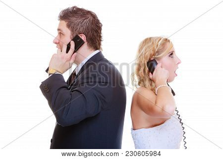 Relationship Problems And Troubles Concept. Groom And Bride Calling To Each Other Having Quarrel Arg