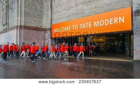 London, Uk - March 10, 2018: School Group In Uniform Enter The Tate Modern, A Modern Art Museum In T