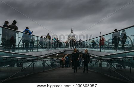 London, Uk - March 10, 2018: Tourists At Millenium Bridge In London, Uk During A Cloudy Day