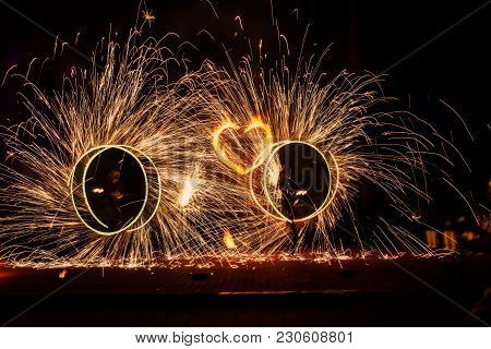 Firework Show Two Circles With Sparks And Fiery Heart Between Them