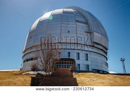 Dome Of Special Astrophysical Observatory On Blue Sky Background At Sunny Day.