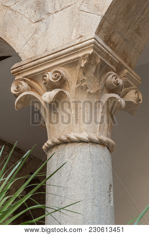 Roman Column From Ancient Times With Floral Decoration In Trogir, Croatia.